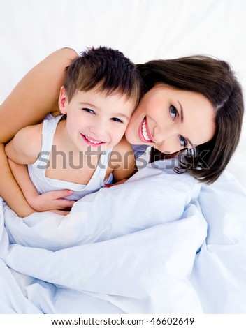 Happy  young mother and her pretty son - stock photo