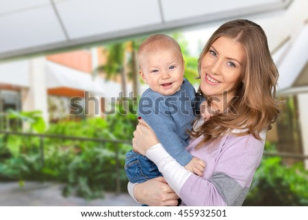 Happy young mother and her son  - stock photo