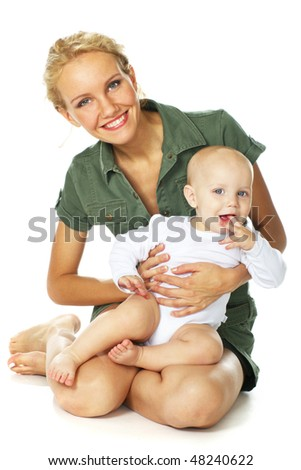 happy young mother holding her baby boy sitting over white - stock photo