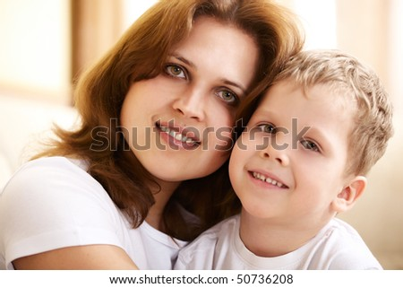 happy young mother hugging her little son at home - stock photo