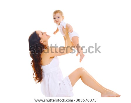 Happy young mother playing with cute baby on a white background - stock photo