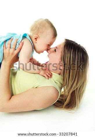 happy young mother playing with her baby - stock photo
