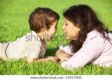 happy young mother playing with her son outdoor