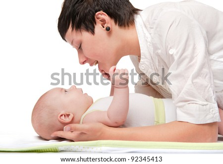 happy young mother with a baby on a white background