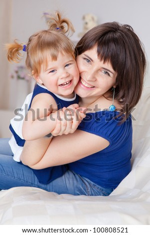 Happy young mother with a cute daughter