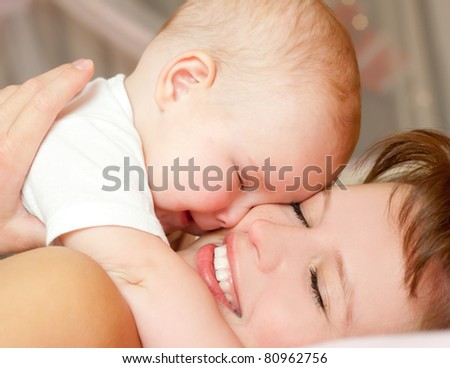happy young mother with baby - stock photo