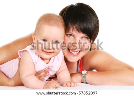 Happy young mother with her five months old baby girl with blue eyes smiling - stock photo