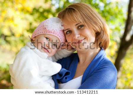 Happy young mother with her little daughter - stock photo
