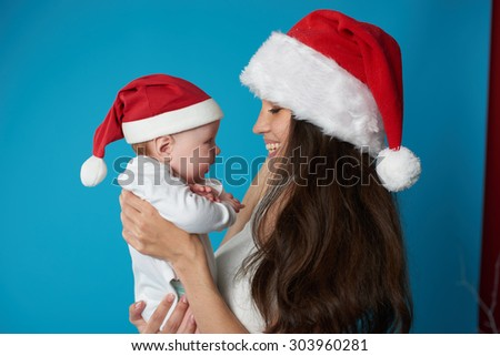 Happy young mother with her sweet baby