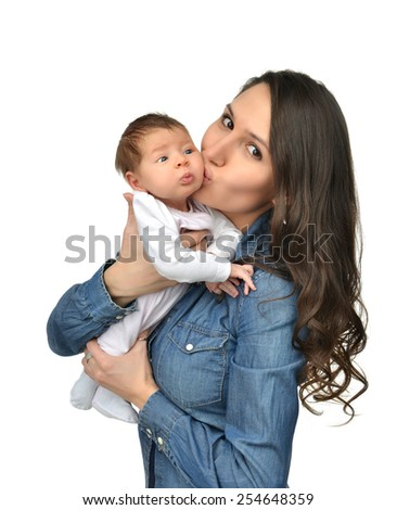 Happy young mother woman hold and kissing beautiful infant child baby kid girl and smiling on a white background - stock photo