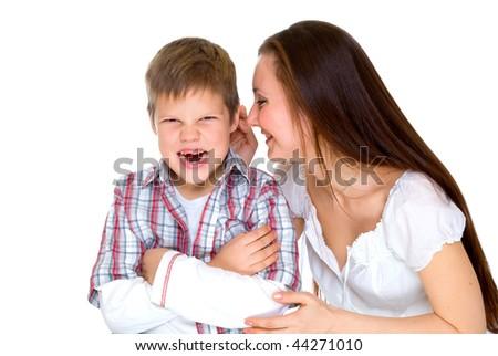 happy young mum cheers sad scream son - stock photo