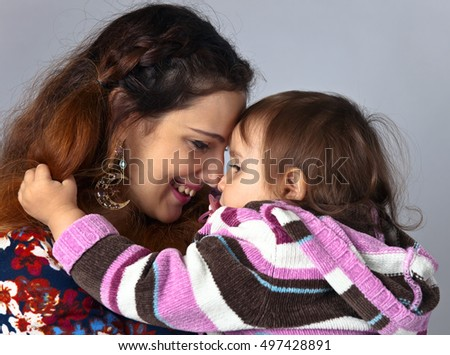 Happy young mum with the little daughter