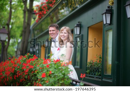 Happy young newly-wed couple on a balcony of their house or hotel room