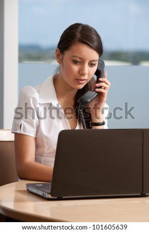 Happy young office worker - stock photo