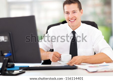 happy young office worker drinking coffee - stock photo