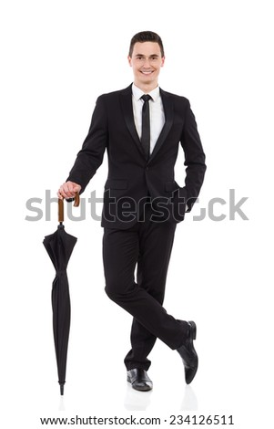 Happy young office worker standing with umbrella. Full length studio shot isolated on white. - stock photo