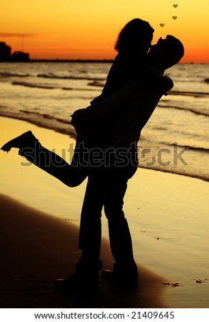 Happy young pair on a sunset - stock photo