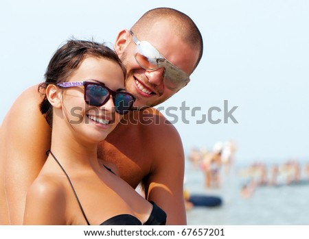 Happy young pair on a vacation - stock photo