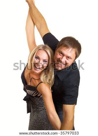 Happy young pair pose on a white background - stock photo