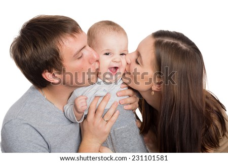 Happy young parents hug and kiss a beloved son - stock photo