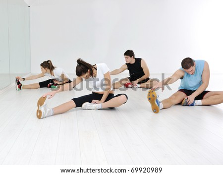 happy young people group in excercise and relax in  fitness club - stock photo