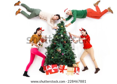 Happy young people in Christmas - stock photo