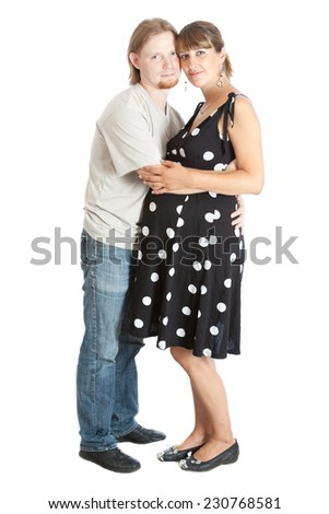 happy young pregnant woman and her husband - stock photo