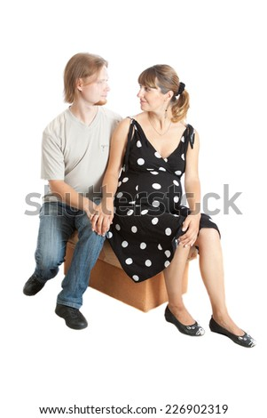 happy young pregnant woman and her husband sitting - stock photo