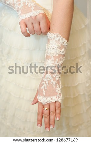Happy young pretty bride on her wedding day. beautiful bride in a luxurious wedding dress. Bridal wedding bouquet of flowers. - stock photo
