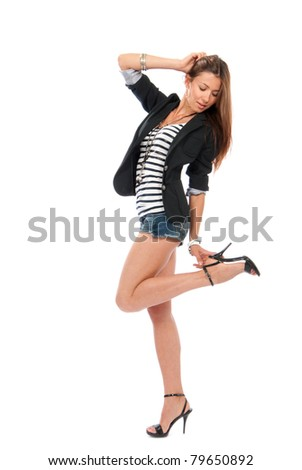 Happy young pretty full body brunette woman dancing in casual cloth with touching hill isolated on a white background - stock photo