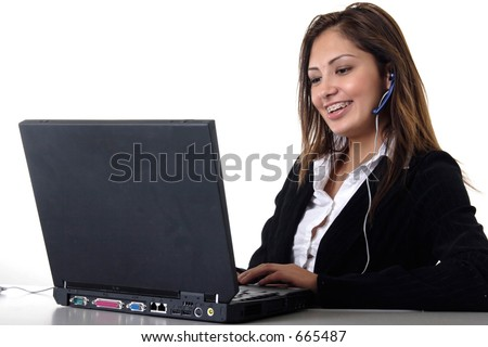 Happy young receptionist wearing headset