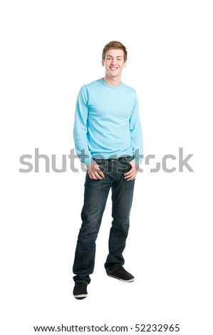 Happy young relaxed man smiling and standing isolated on white background - stock photo