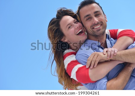 happy young romantic couple have fun relax smile at modern home indoor and outdoor - stock photo