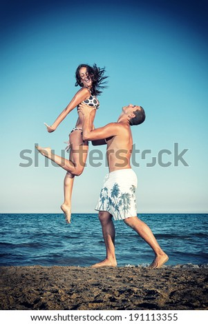 happy young romantic couple in love have fun and relaxing on beautiful beach - stock photo