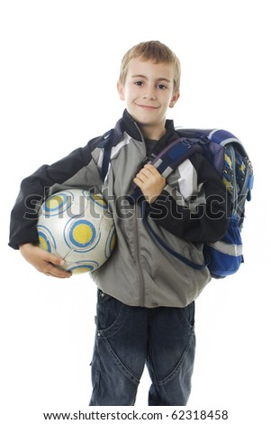 Happy young school boy holding a football ball isolated on white - stock photo