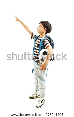 Happy young school boy holding a football, pointing. Isolated on white background   - stock photo