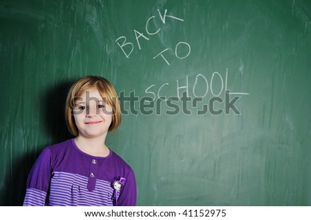 happy young school girl portrait on math class