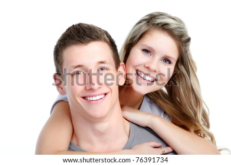 Happy young smiling couple in love. Over white background