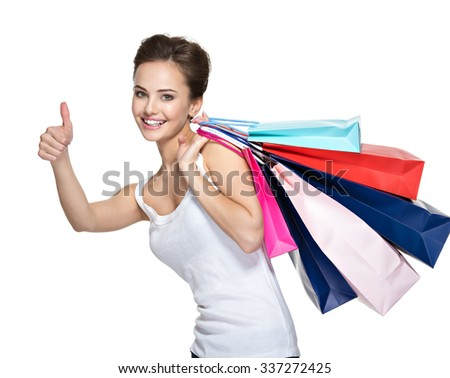 Happy young smiling woman with shopping bags after shopping - stock photo