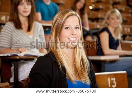 Happy young student at university class - stock photo