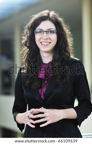 happy young student girl possing at university campus and reopresenting education concept - stock photo