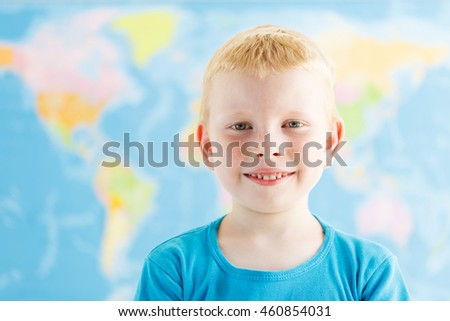 Happy young student in a classroom of geography