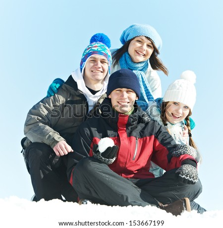 happy young student people group in warm clothing on snow at winter outdoors - stock photo