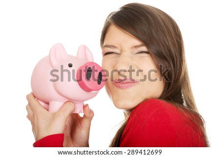 Happy young student woman with piggybank. - stock photo