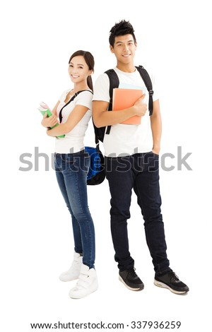 Happy young students couple with books  - stock photo