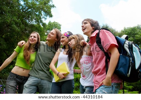 happy young students in park - stock photo