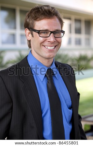Happy young successful business man - stock photo