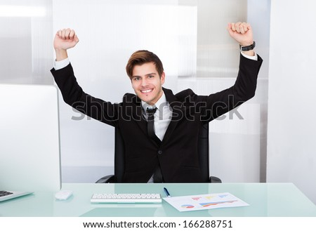 Happy Young Successful Excited Businessman Raising Hand