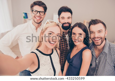 happy young successful group of businesspeople   make selfie photo and smiling - stock photo