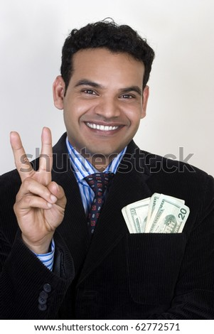 happy young successful man giving tips to make money - stock photo